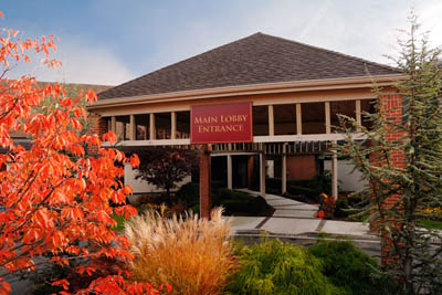 Front entrance to the Watermark at East Hill with fall foliage