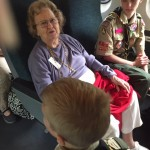 The Boy Scouts enjoyed visiting with the residents on the train.