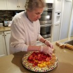 One of our residents putting together a fruit tray for all to enjoy.