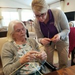 Lisa, one of our Nayas, learning from one of our residents.