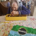 Planting herbs in The Villa, our memory care community, at The Watermark at East Hill