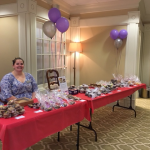 Theresa, one of our Community Life Associates, selling baked goods to raise money for our team, The Watermark Warriors.